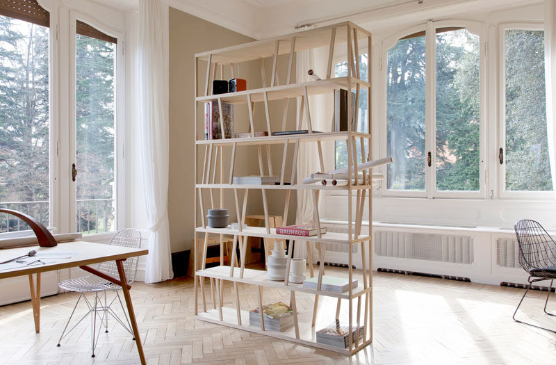 Room Divider Ideas - 10 Examples Of Multi-Functional Room Dividers // This simple two-in-one room dividing bookshelf is great for tiny apartments or in spaces where a full dividing wall isn't necessary.