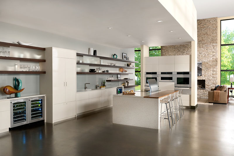 Kitchen Design Idea - Open Shelving (19 Photos) // Long open shelves are broken up with pieces of frosted glass to keep the less beautiful pieces slightly out of focus.