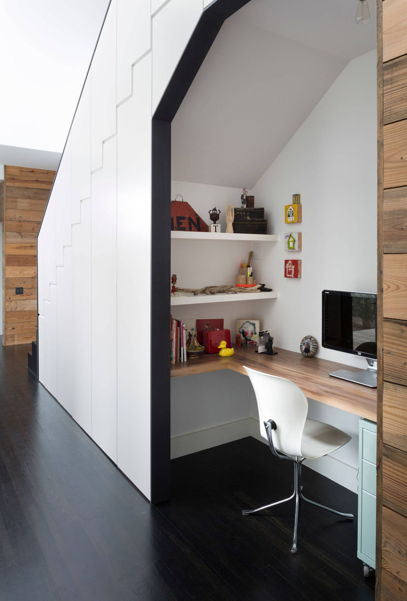 10 Small Home Office Ideas - This desk tucked under the stairs features a wrap around desk, two wall mounted shelves, and a small filing cabinet - all the essentials you need for a functional home office.