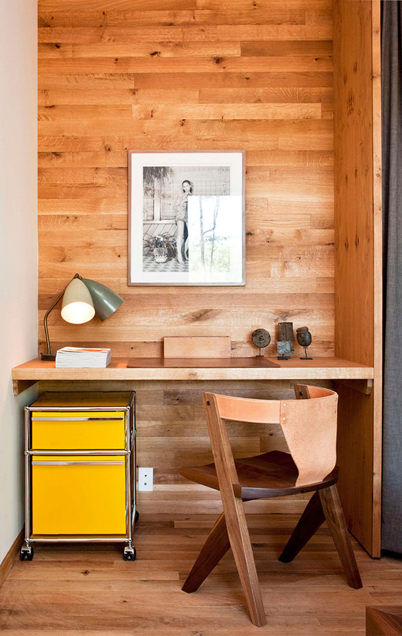 10 Small Home Office Ideas - Wood panels lining the wall of this alcove designate the office space, and the mini yellow filing cabinet adds a fun pop of color, livening up the corner. #HomeOffice #SmallHomeOffice #SmallDesk #InteriorDesign
