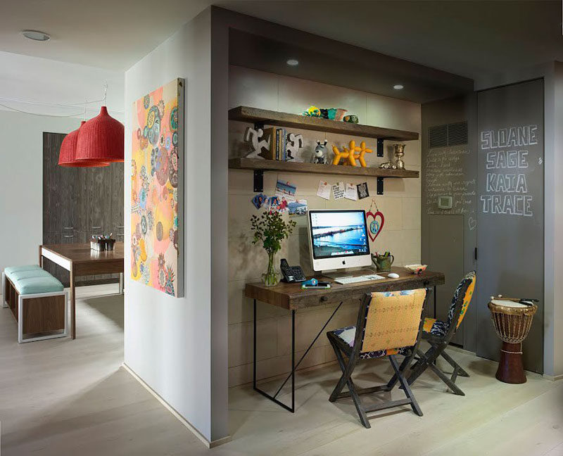 10 Small Home Office Ideas - Tucked into the wall just beside the kitchen sits this family home office. Two shelves and a matching desk provide lots of storage space, and a chalkboard wall makes for a fun place to leave messages for the rest of the family. #HomeOffice #SmallHomeOffice #SmallDesk #InteriorDesign