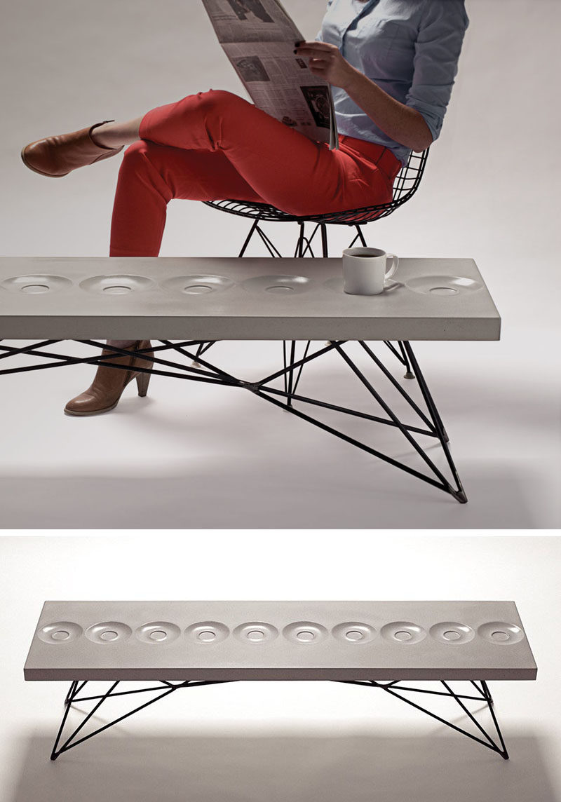 10 Examples Of Concrete and Steel Tables To Add To Your Industrial Interior // This concrete and steel coffee table has saucers built right into the surface to give you a convenient place to sit your coffee while you flip the page of your morning paper.