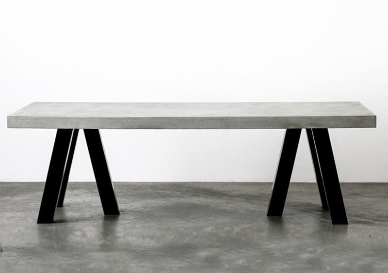 10 Examples Of Concrete and Steel Tables To Add To Your Industrial Interior // Black chunky steel legs and a thick layer of concrete on top make this dining table a solid statement piece.