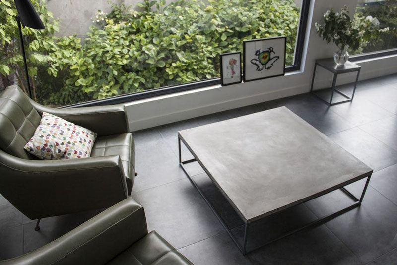 10 Examples Of Concrete and Steel Tables To Add To Your Industrial Interior // A simple minimalist square table lets the steel and concrete do all the talking.
