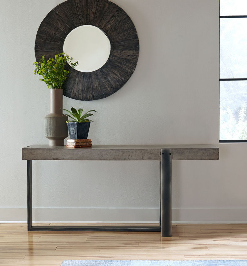 10 Examples Of Concrete and Steel Tables To Add To Your Industrial Interior // The unique design of the legs of this table adds a sculptural element to it and turns it into an artistic detail.