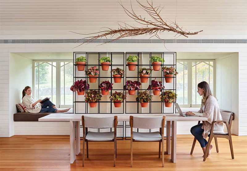 This standalone room divider is perfect for creating a vertical garden.