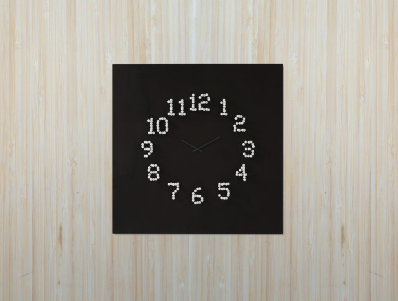 When you move around this clock, for example side to side, the numbers dissolve and transform into different shapes, resulting in an optical illusion and making the clock appear more as a piece of art than a device to tell time.