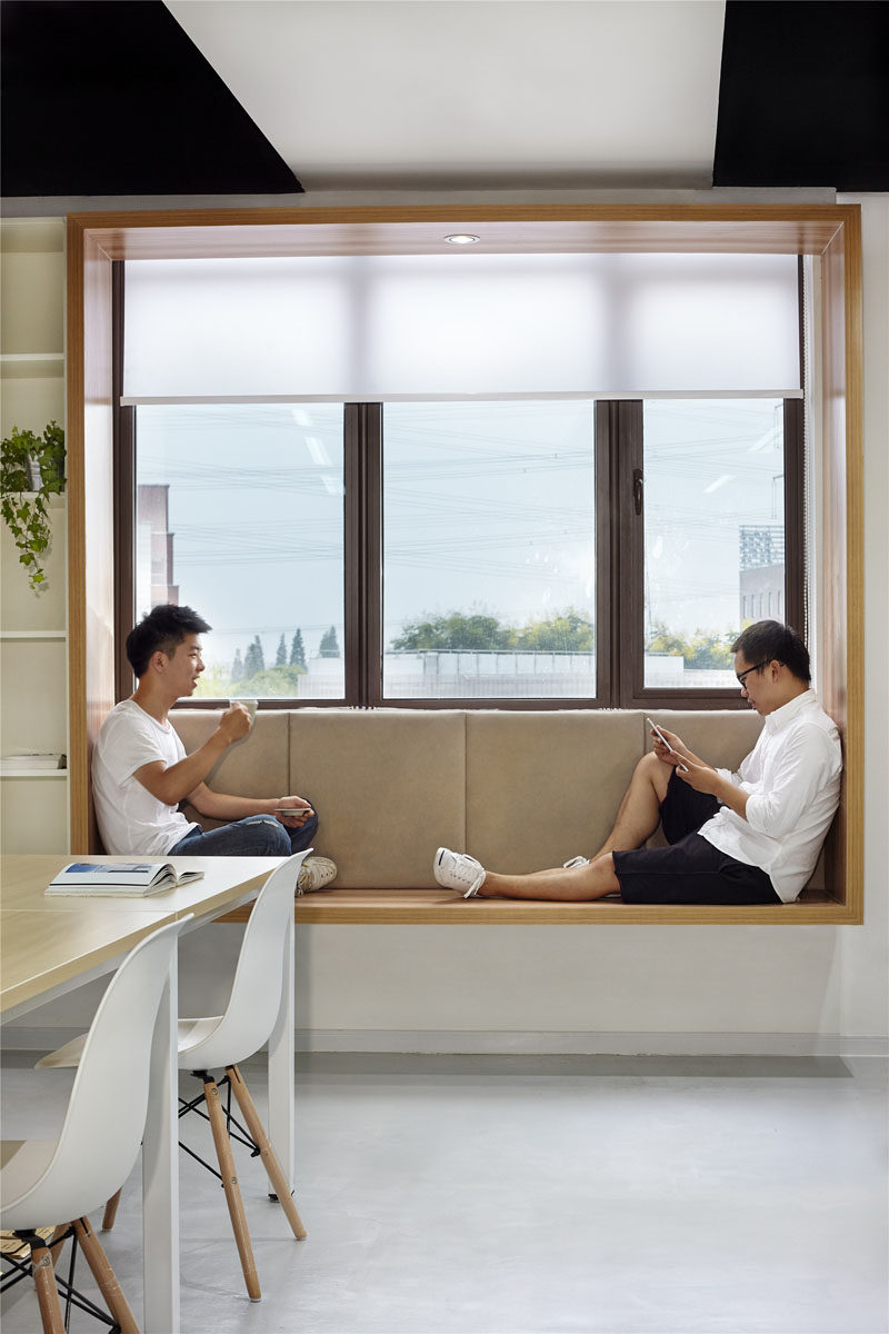Modern Window Seat Idea - Add a suspended wood surround to standard windows to create an activated space. #ModernWindowSeat #WoodLinedWindowSeat #WorkplaceDesign #OfficeDesign