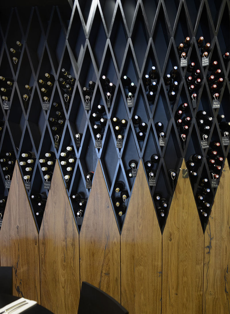 Wine Rack Idea A Wine Wall Made Of Diamond Shaped Shelves