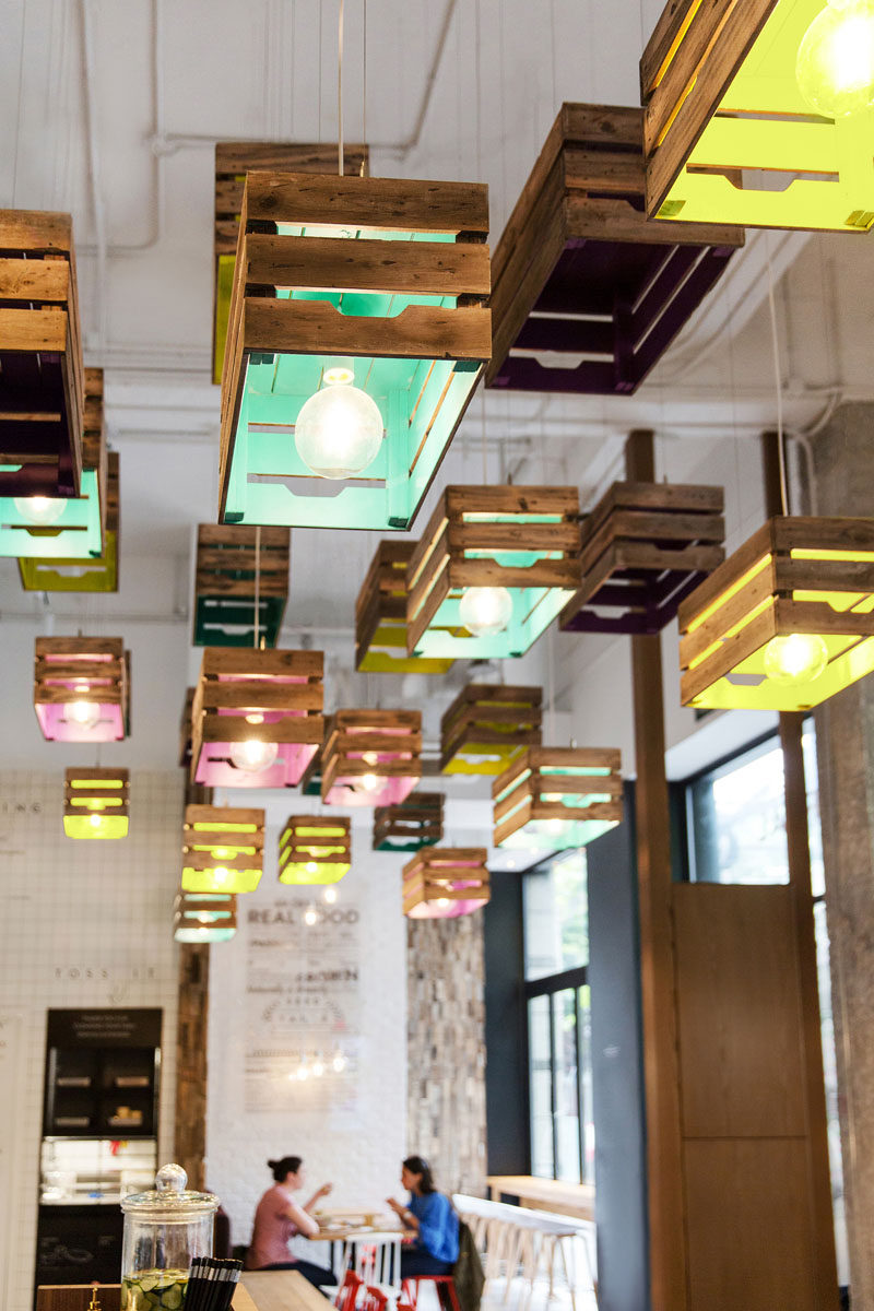 Lighting Design Idea - Painted wooden crates have been used to create pendant lighting in this restaurant.