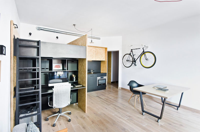 Charmant This Small Apartment With Lofted Bed, Has Been Designed As A Live/work Space