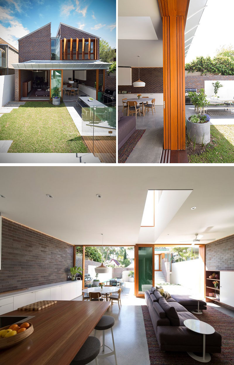 23 Awesome Australian Homes That Perfect Indoor / Outdoor Living // Large doors open up both sides of this home and connect it to the backyard. One side leads out onto the grassy part of the yard while other leads onto a paved dining area with a long table and large BBQ.