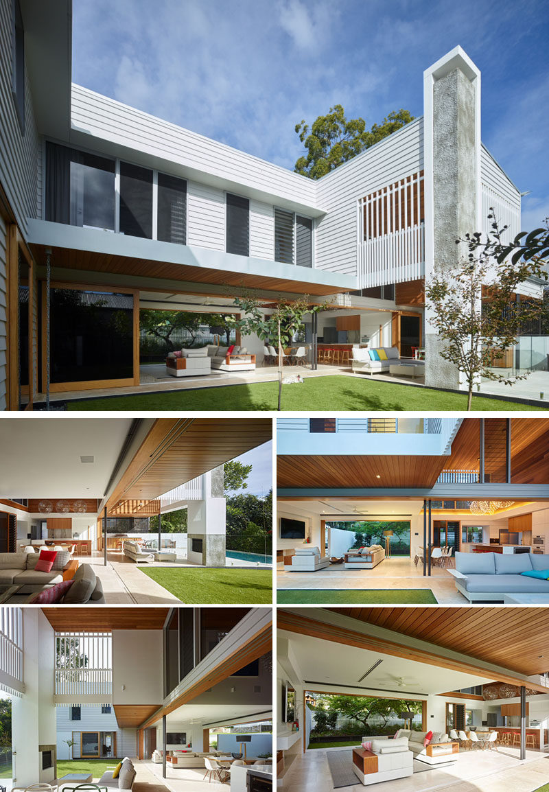23 Awesome Australian Homes That Perfect Indoor / Outdoor Living // Massive sliding glass doors can be opened to connect the bottom level of the house with the outdoor entertaining area that includes a fireplace, lounge, dining area, backyard, and pool.