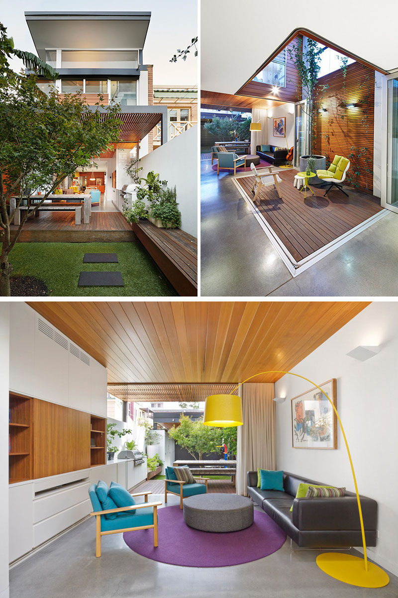 23 Awesome Australian Homes That Perfect Indoor / Outdoor Living // The back of this home opens up into the backyard and has cabinetry that extends from the indoor entertainment unit onto the deck, that houses a large built-in barbeque. Other areas of the home are also connected to the outdoors with folding glass doors that open up onto patios right inside the home.