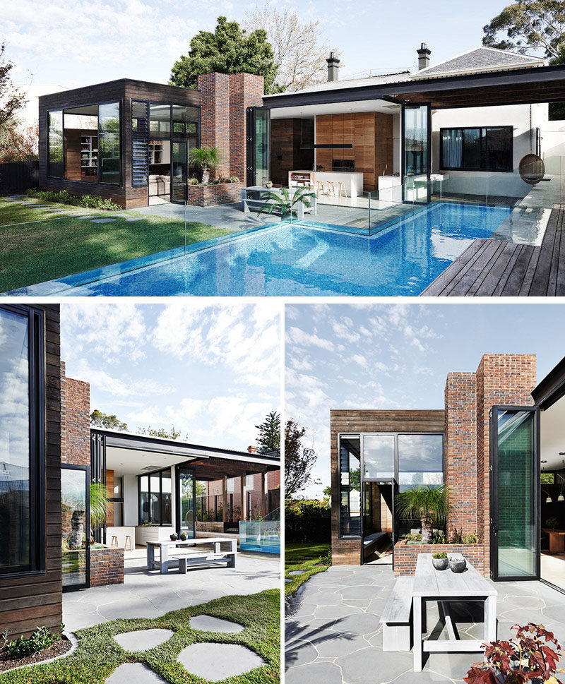 23 Awesome Australian Homes That Perfect Indoor / Outdoor Living // Tall glass doors and windows open onto this backyard, and connect the kitchen and living room to the festivities going on outside on the patio and in the pool.
