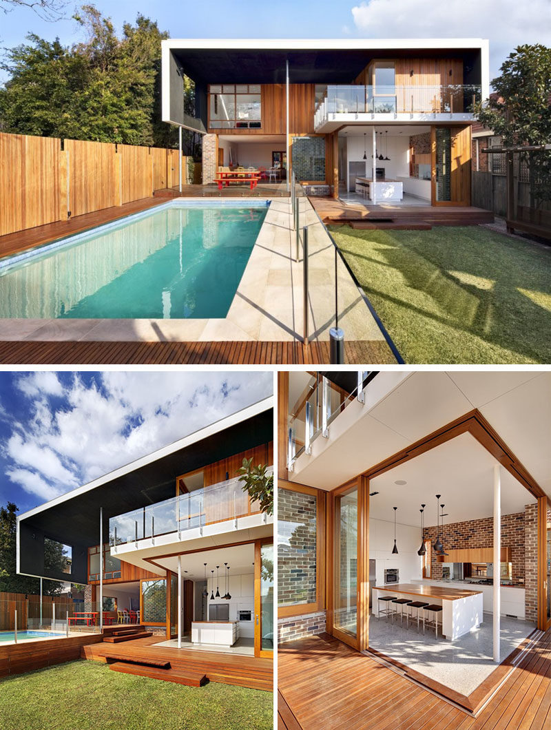 23 Awesome Australian Homes That Perfect Indoor / Outdoor Living // The kitchen and dining room in this home both open up completely to the outside making it easy to keep an eye on what's happening in the yard and letting a cool breeze float through the lower level of the home.