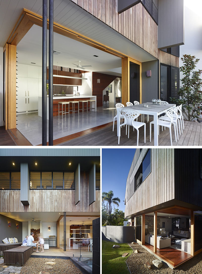 23 Awesome Australian Homes That Perfect Indoor / Outdoor Living // The kitchen of this home connects to a dining patio and entertaining area with a wood burning fireplace, barbeque, and built-in seating.