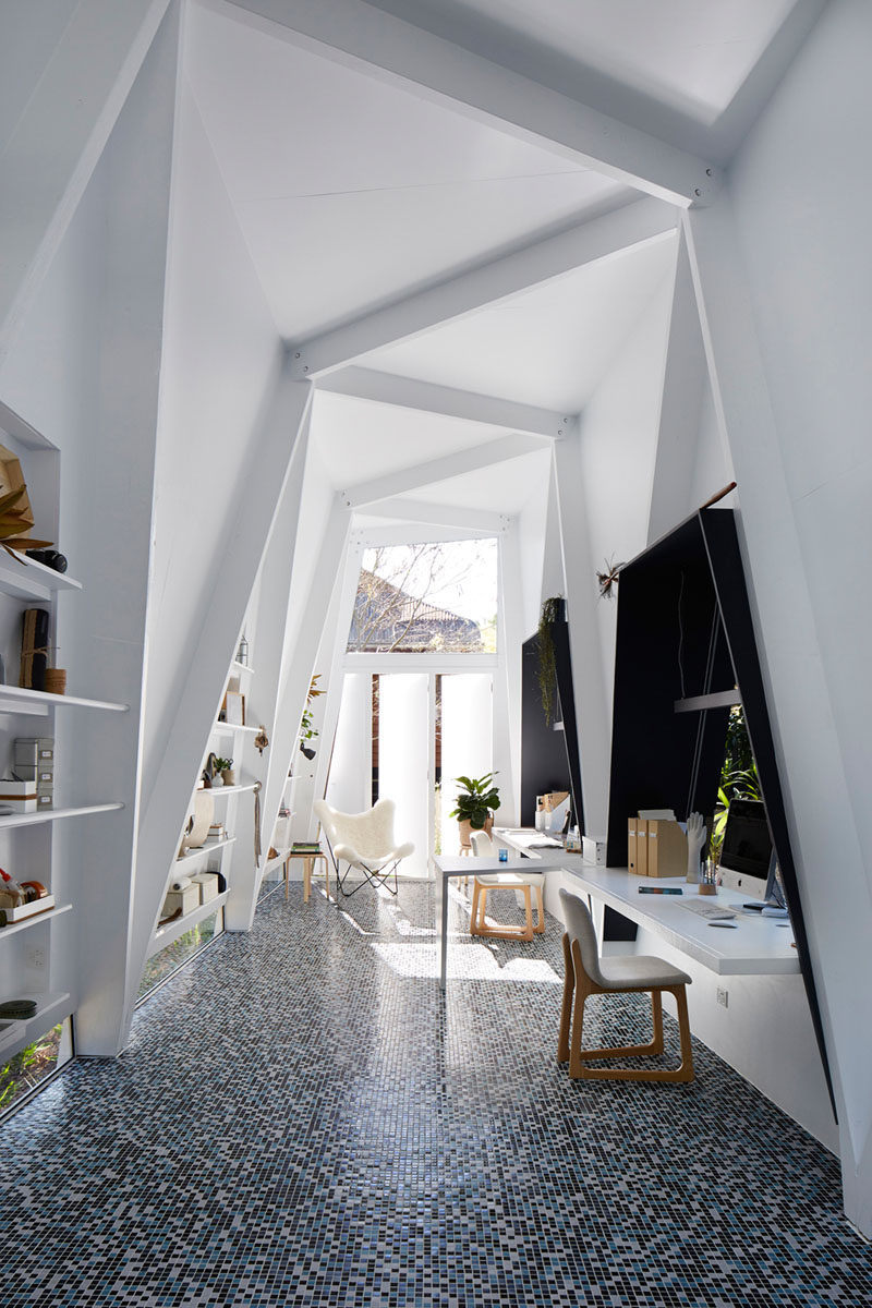 This bright white backyard studio was designed for a couple of interior stylists.