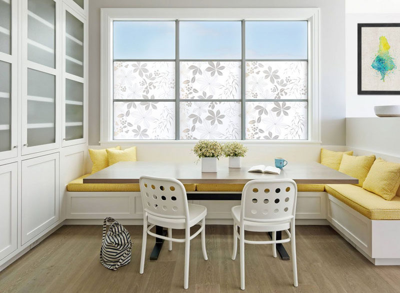 Dining Room Design Ideas - Use Built-In Banquette Seating To Save Space // Bright yellow upholstery and cushions used to soften the banquette brighten this mostly-white corner dining area.
