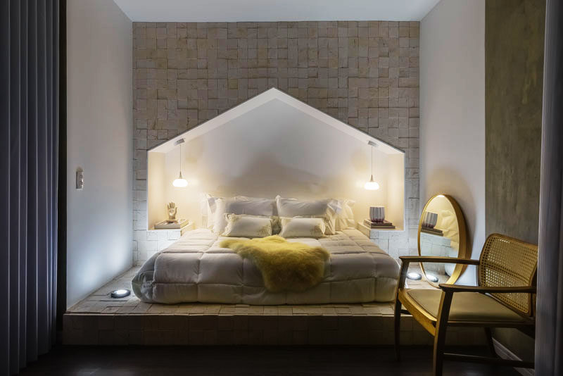 Bedroom Design Idea – This bed has a surround shaped like a house with a peaked roof