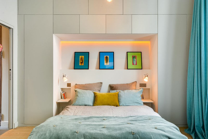 Bedroom Design Ideas - 8 Ways To Create The Ultimate Bed Surround With Storage // Personalize Your Space With Art -- Include a small shelf between the cabinets to create the perfect spot to prop up some of your favorite art pieces or hang them directly on the wall.