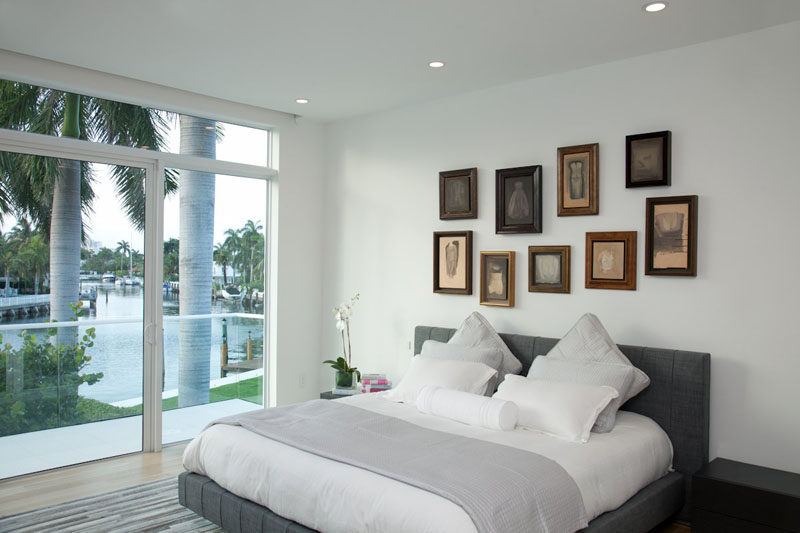 Bedroom Design Ideas - 8 Ways To Decorate The Wall Above Your Bed // Artwork - What better place to hang a favorite piece of art than above your bed. It'll fill the empty space and adds personality to your bedroom.