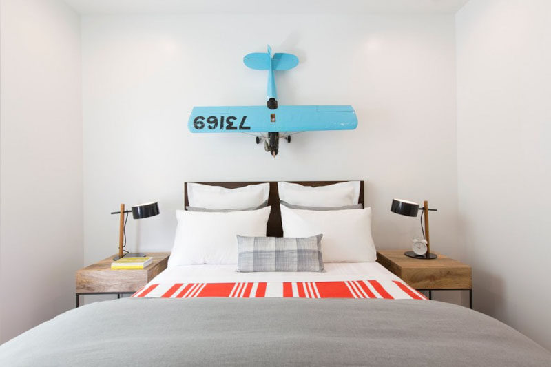 Bedroom Design Ideas - 8 Ways To Decorate The Wall Above Your Bed // Artistic Installation - 3D sculptural pieces add dimension, color, and personality to the empty space above the bed and is a great way to showcase your passions.