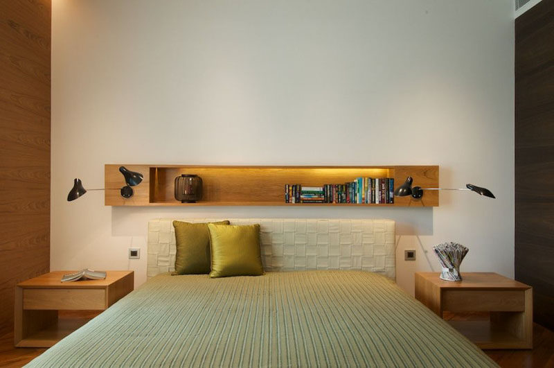 Bedroom Design Ideas - 8 Ways To Decorate The Wall Above Your Bed // Shelves - Adding shelves above the bed adds an extra spot for storing things and can keep your favorite little bits and pieces close to you while you sleep.
