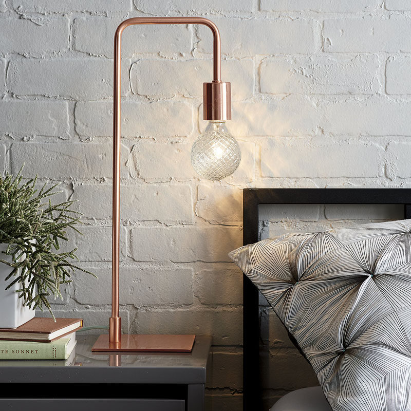 12 Bedside Table Lamps To Dress Up Your Bedroom // Arc Copper table lamp from CB2