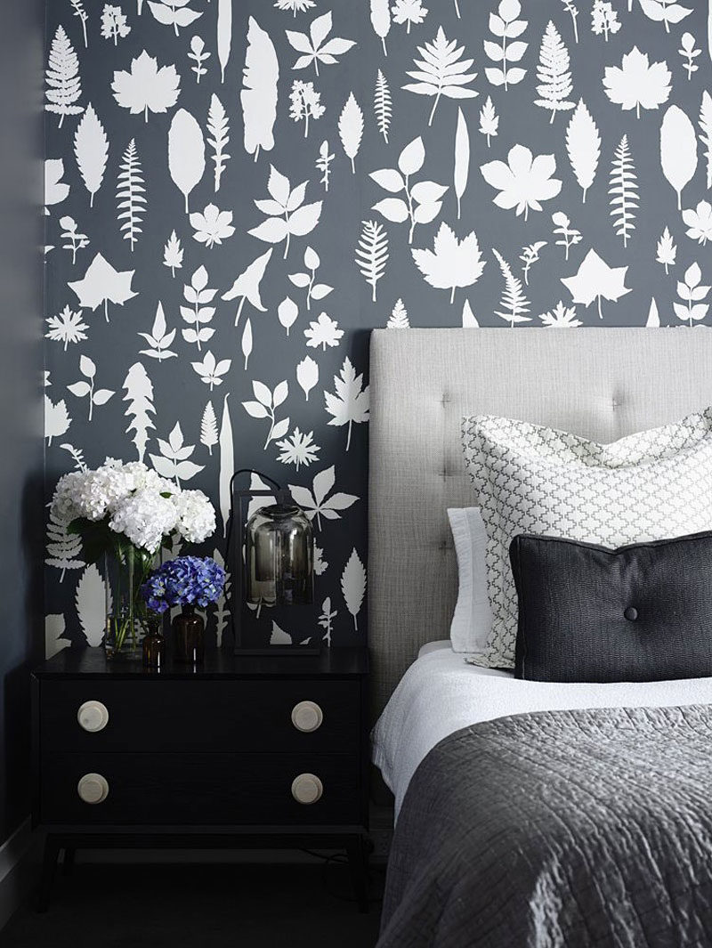 17 Ways To Introduce Botanical Designs Into Your Home Decor // This bedroom incorporates the botanical trend by using a gray and white botanical inspired wallpaper.