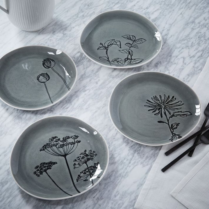 17 Ways To Introduce Botanical Designs Into Your Home Decor // These plates are a super subtle way to add some botanicals to your table.