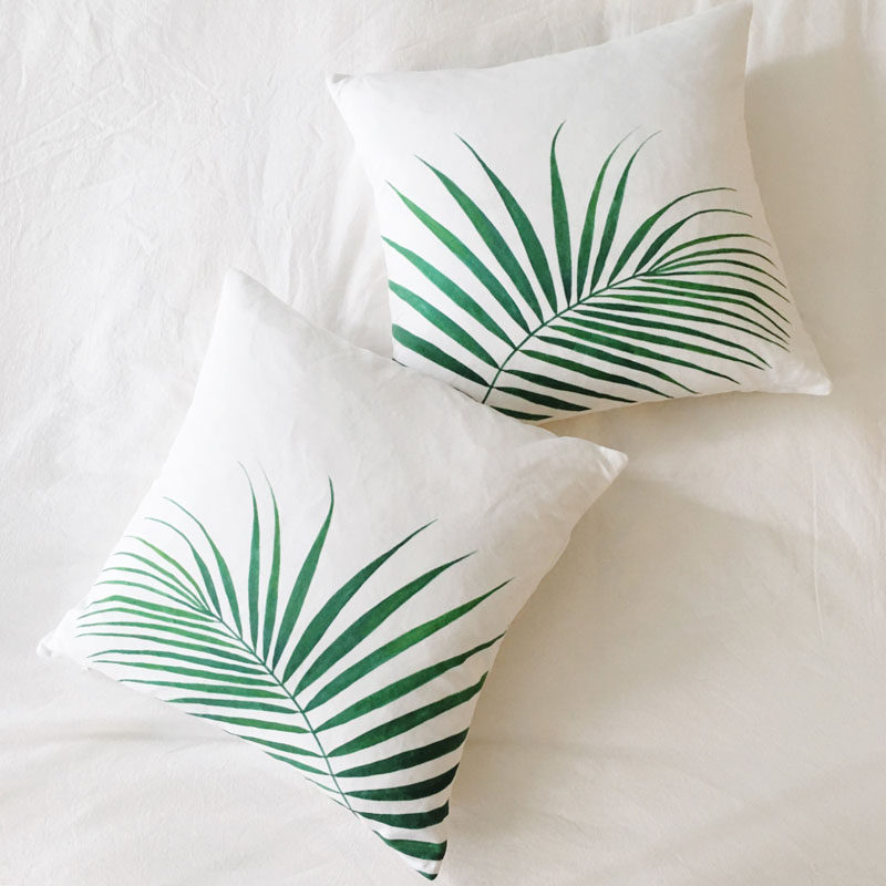 17 Ways To Introduce Botanical Designs Into Your Home Decor // These simple palm leaf pillows add a touch of the botanical trend to your couch and give you a comfy place to rest your head.