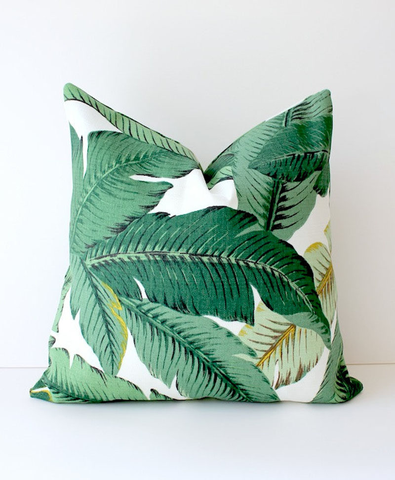 17 Ways To Introduce Botanical Designs Into Your Home Decor // Add a statement pillow to your couch collection with these tropical leaf pillows that bring color, comfort and botanicals into your home.