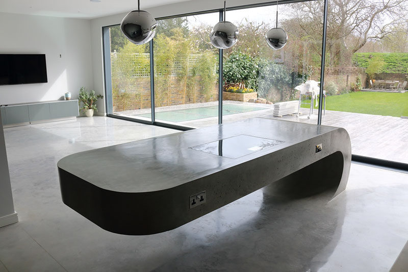 23 Pictures That Show How Concrete Floors Have been Used Throughout Homes // Polished concrete floors in the kitchen and dining area are a great idea because they're easy to clean and extremely durable, just try not to drop anything breakable.