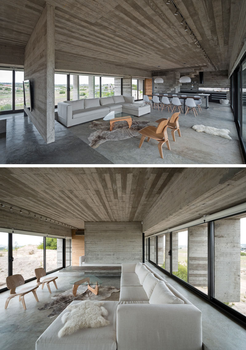 23 Pictures That Show How Concrete Floors Have been Used Throughout Homes // Concrete in the living room may sound cold and uninviting but if it's layered with blankets, pillows, and comfy cushions, the opposite ends up being true.