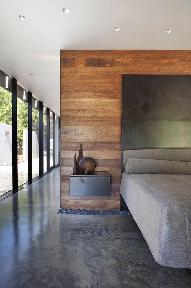 23 Pictures That Show How Concrete Floors Have been Used Throughout Homes // Polished concrete floors in the bedroom create a clean, industrial feel that gets softened and warmed with the addition of bedroom textiles like duvets, pillows, rugs, and drapery.