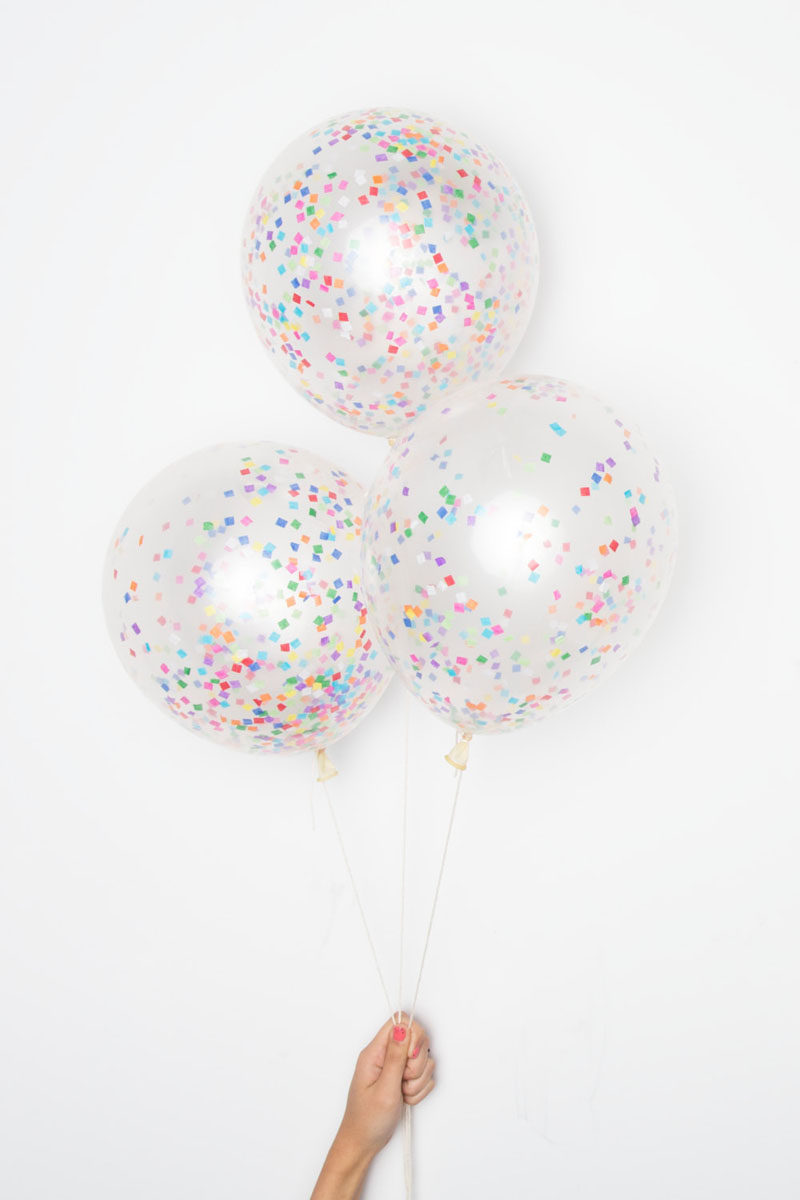 5 Essentials You Need When Hosting An Awesome Modern Tea Party // Confetti-filled balloons bring color and fun to the party and give a youthful feel to the gathering.