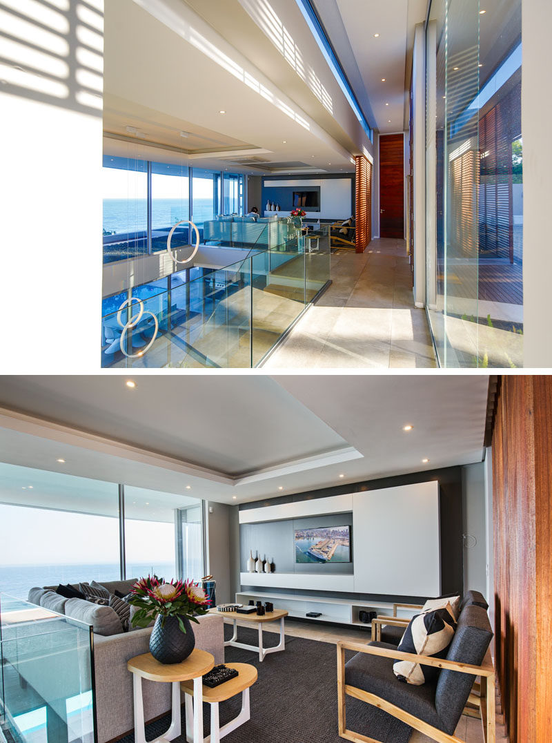 Just inside the entrance to this home there's a TV lounge that connects to a double volume space that lets you look down over the dining room below.