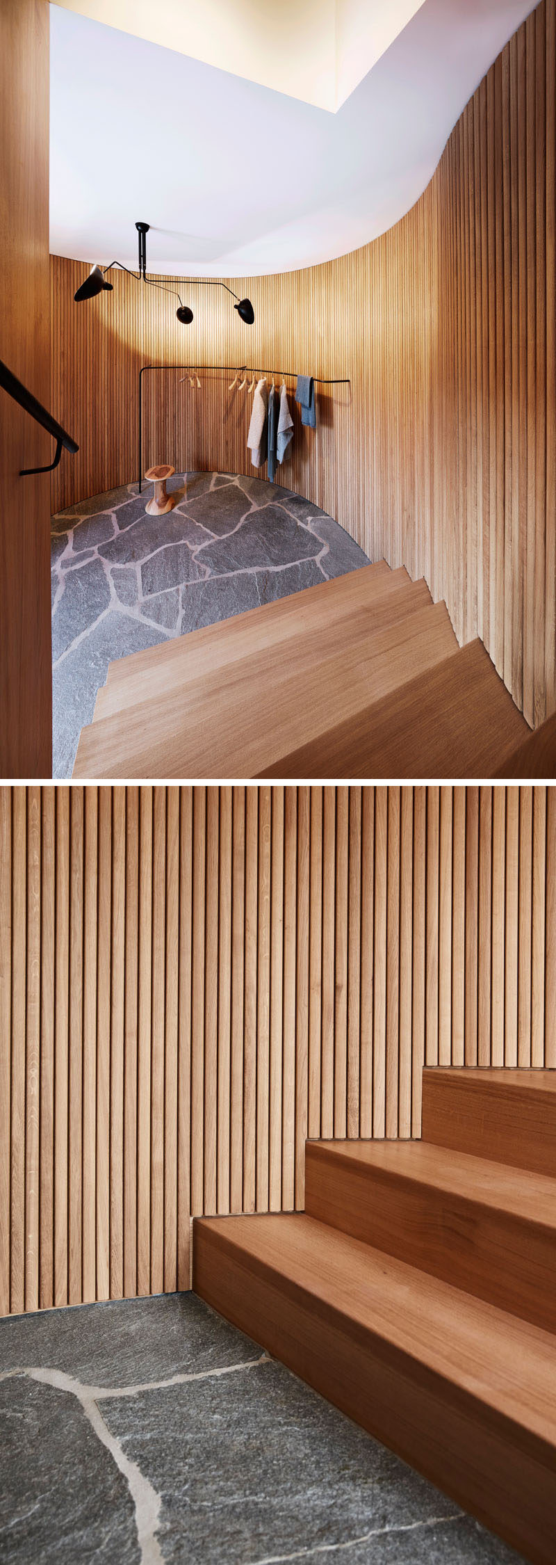 These stairs are surrounded by wooden slats that curve around and create a softer look for the space. At the bottom of the stairs, a simple rail provides a place to hang outerwear.