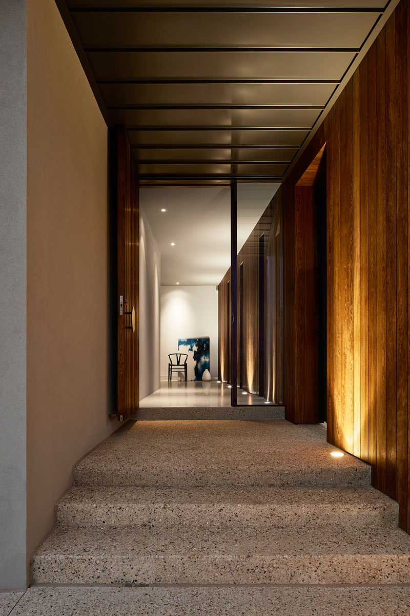 Uplighting has been used at the entrance to this home that follows through into the foyer.