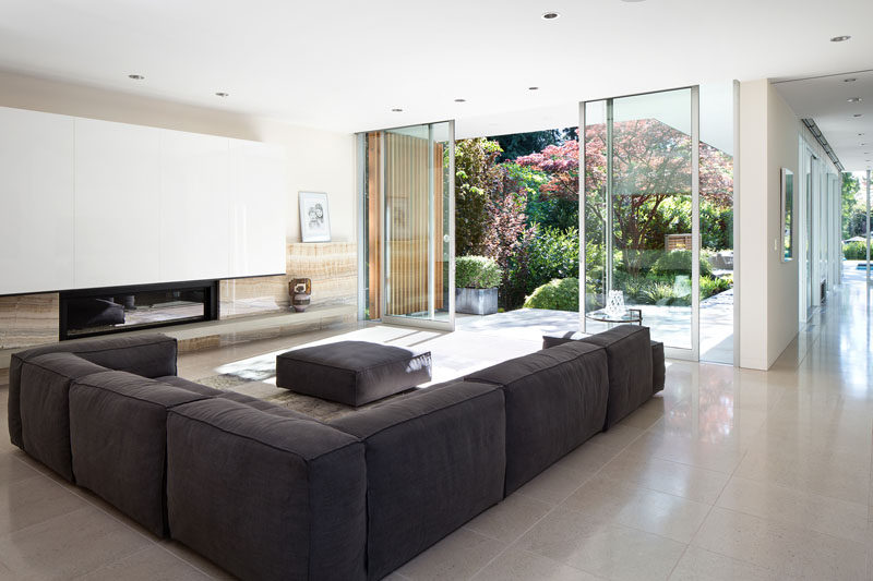 Large floor-to-ceiling sliding glass doors open up this living room to the garden outside.