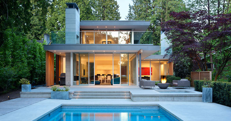 This new modern house in Vancouver is surrounded by tall evergreen trees