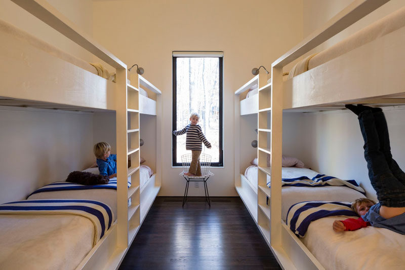 This kids bedroom at a house by the river has built-in bunk beds that can sleep eight.