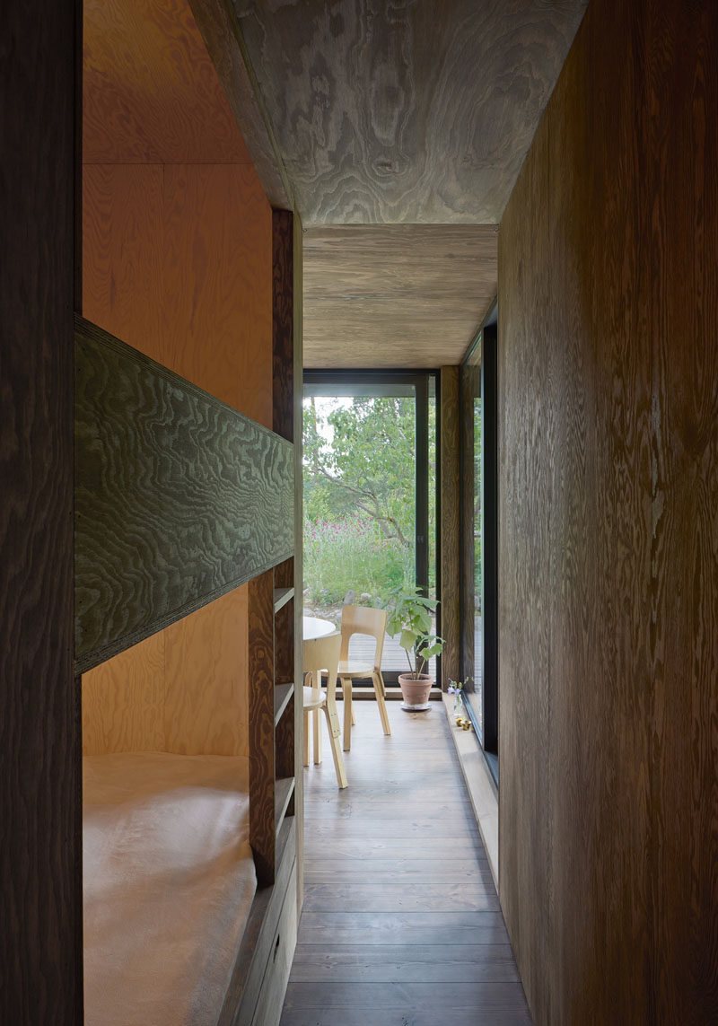 The interiors of this summer house have been kept dark to allow you to focus on the greenery outside.
