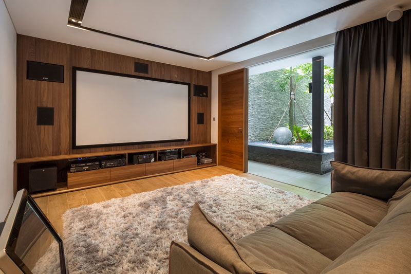 This entertainment room has a built-in wall unit for surround sound, and there's also access to a small landscaped yard.