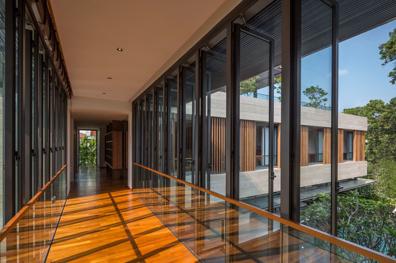 This linkway, which connects two sections of the home, is lined with windows that can be opened to facilitate airflow.