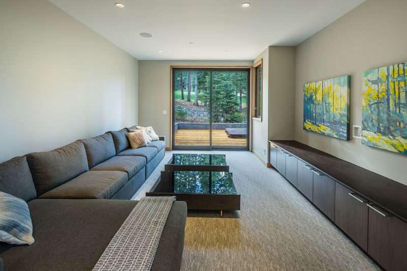 This media room has access to the deck outside through glass sliding doors.