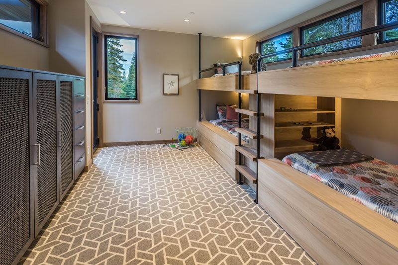 This kids room has been set up with built-in bunk beds (to sleep four) and plenty of storage.