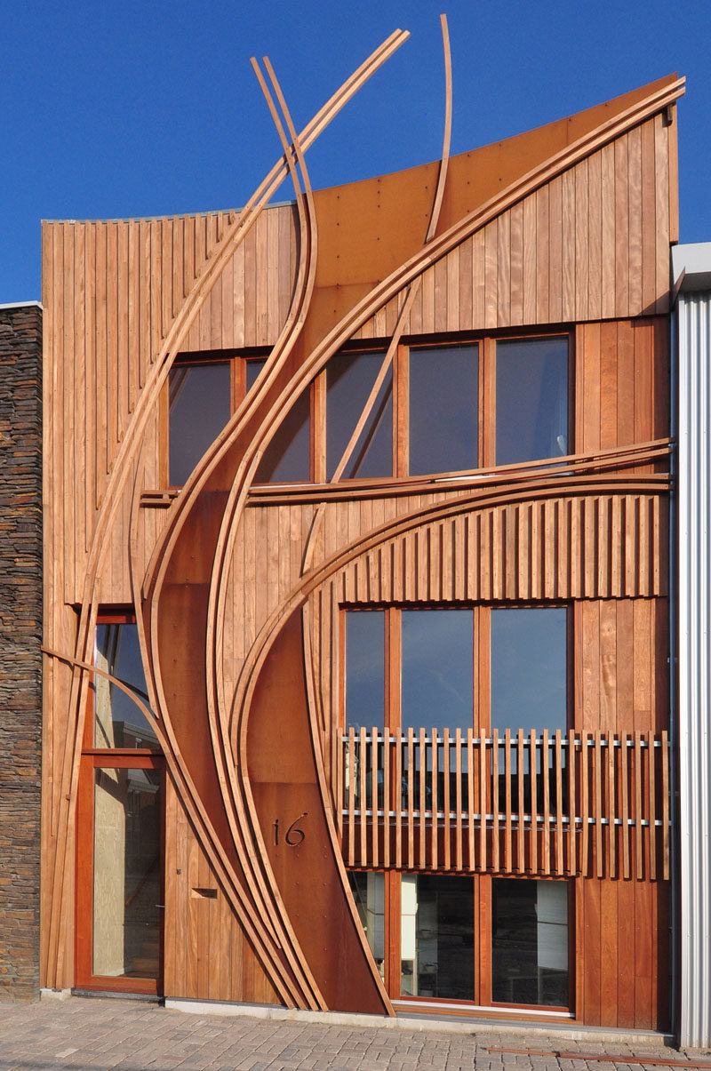 Exterior Design Ideas - 15 Buildings That Have Unique And Creative Facades // Curved weathering steel is worked into the rest of the wood-clad exterior of this home.