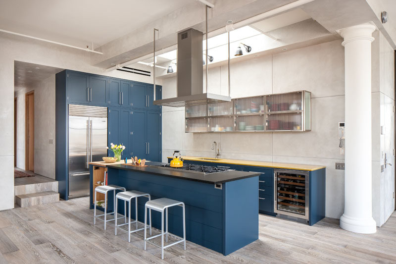 Kitchen Design Ideas - Deep Blue Kitchens // The blue cabinets are lightened up by the skylight above the kitchen and the neutral walls and light wood floors.